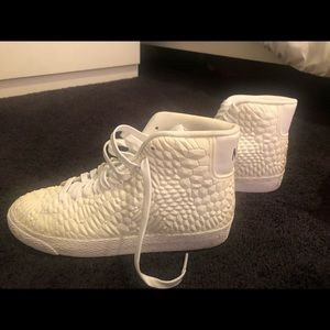 White rigid high top Nike's